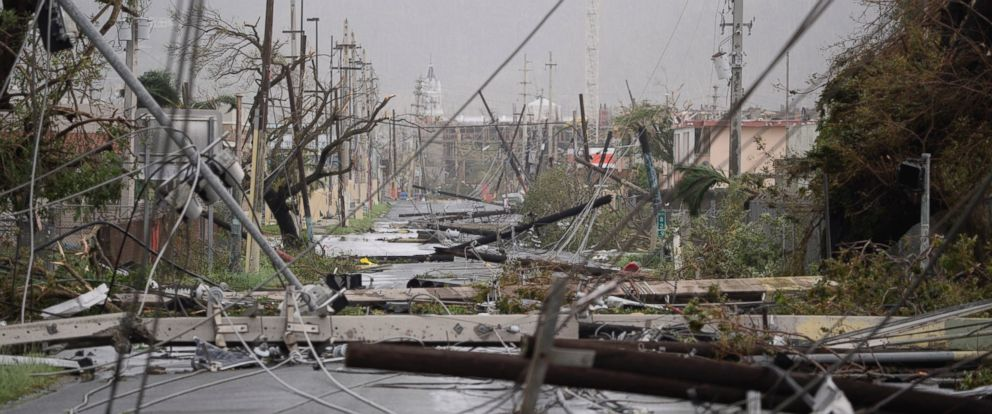 PHOTO: Electricity poles and lines lie toppled on the road after Hurricane Maria hit the island, Sept. 20, 2017, in Humacao, Puerto Rico.