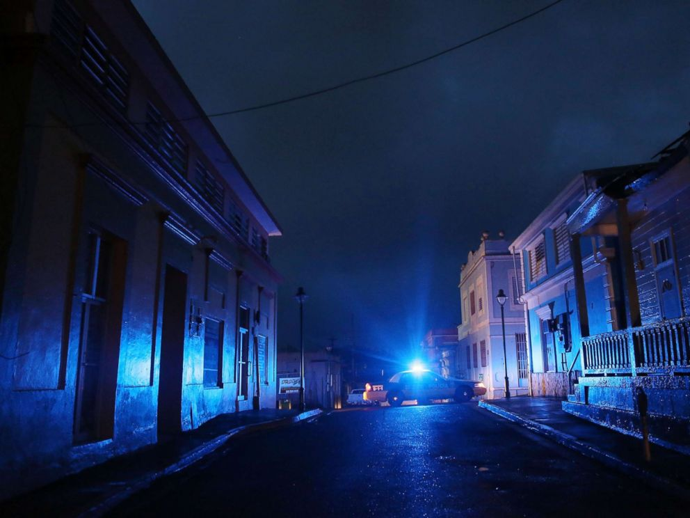 PHOTO: In this Oct. 11, 2017 file photo, A police car patrols on a darkened street three weeks after Hurricane Maria hit the island, in Aibonito, Puerto Rico.