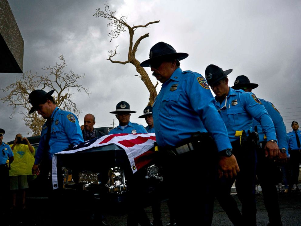 PHOTO: Honor guards carry the coffin of policeman Luis Angel Gonzalez Lorenzo, killed during Hurricane Maria when he tried to cross a river by car, during his funeral at the cemetery in Aguada, Puerto Rico, Sept. 29, 2017.