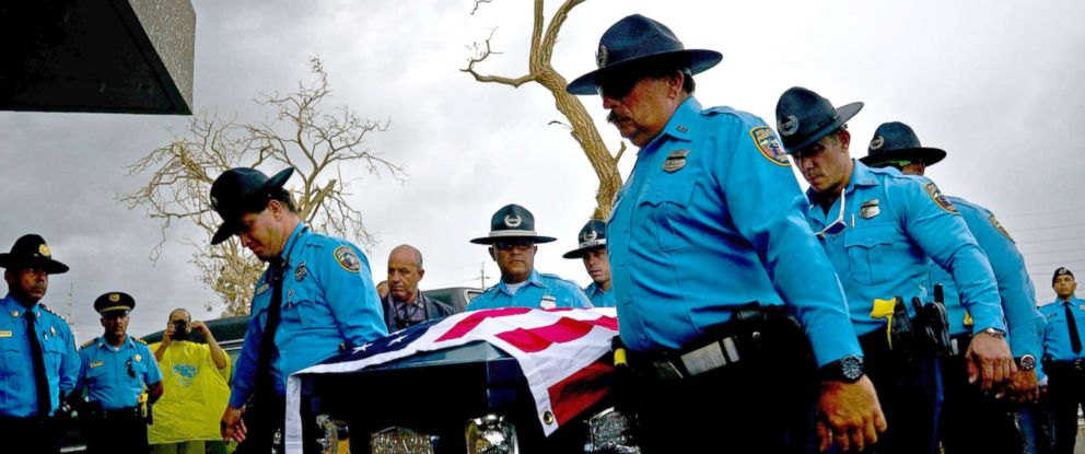 PHOTO: Honor guards carry the coffin of policeman Luis Angel Gonzalez Lorenzo, killed during the passage of Hurricane Maria when he tried to cross a river by car, during his funeral at the cemetery in Aguada, Puerto Rico, Sept. 29, 2017.
