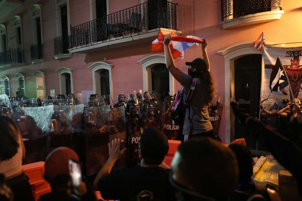 PHOTO: Demonstrators and police face off during a protest against Ricardo Rossello, the governor of Puerto Rico on July 17, 2019, in Old San Juan, Puerto Rico.