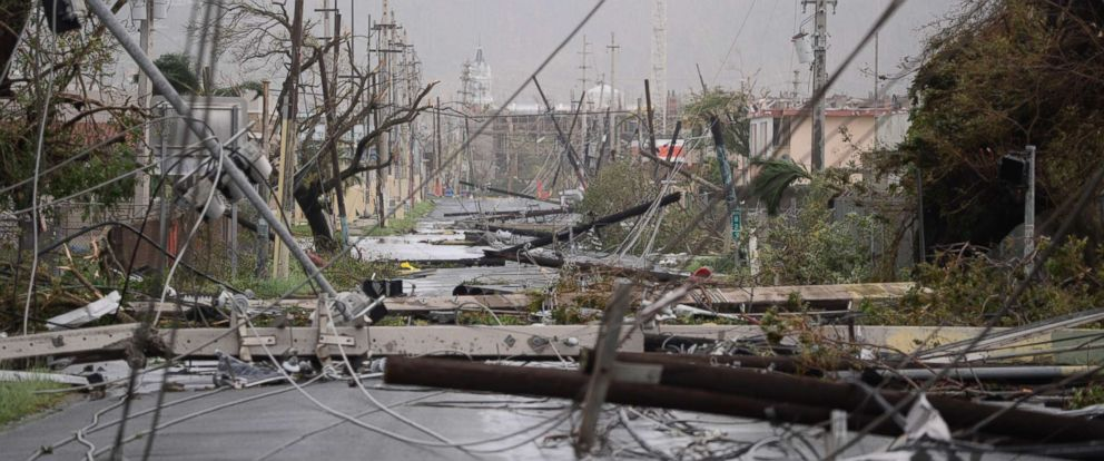 PHOTO: Electricity poles and lines lay toppled on the road after Hurricane Maria hit the eastern region of the island, in Humacao, Puerto Rico, Sept. 20, 2017.