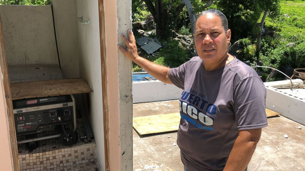 PHOTO: Norma Burgo, who also still does not have power and runs her generator 12 hours. The generator sits inside a bathroom on what was left of the second floor of her home, which was wiped off during the storm.