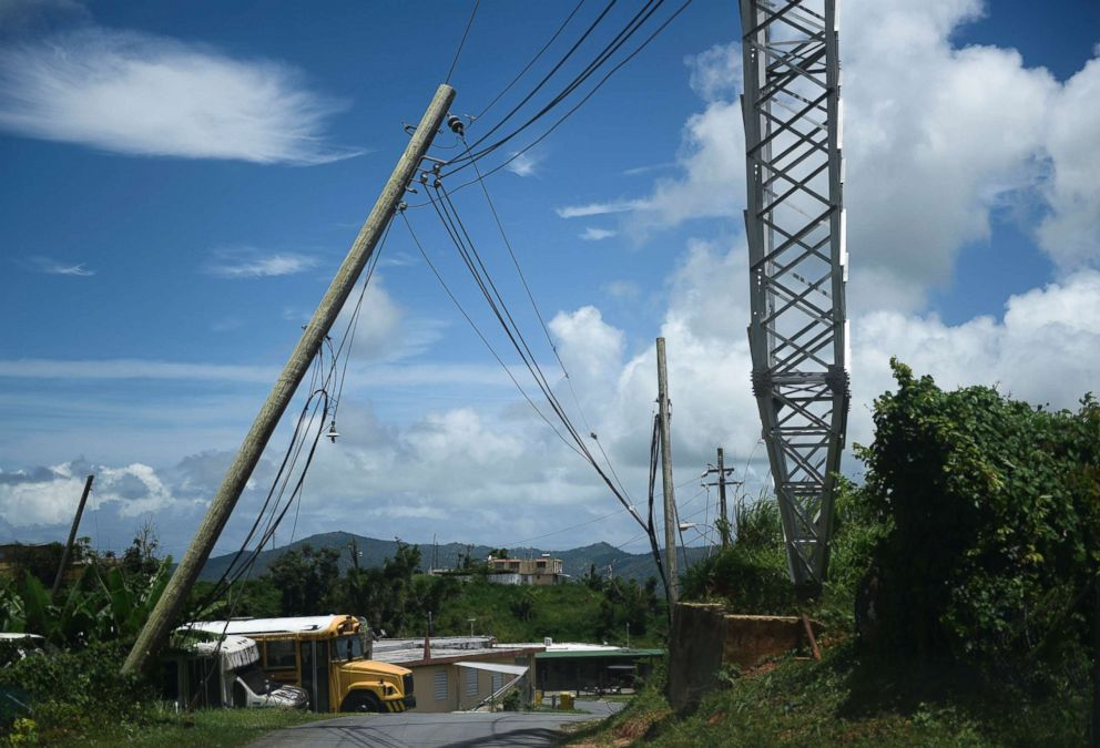 PHOTO: An electric power pole leans over the road in the Piedra Blanca area of Yabucoa, Puerto Rico, May 16, 2018.