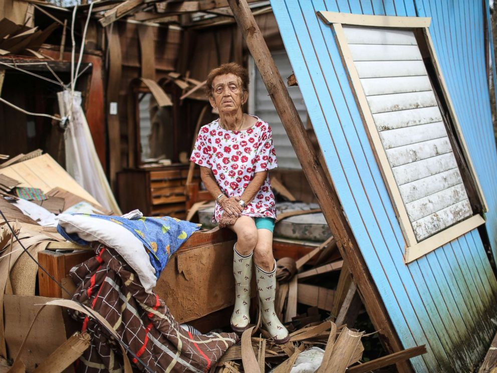 PHOTO: Sonia Torres poses in her destroyed home, while taking a break from cleaning, three weeks after Hurricane Maria hit the island, Oct. 11, 2017, in Aibonito, Puerto Rico.