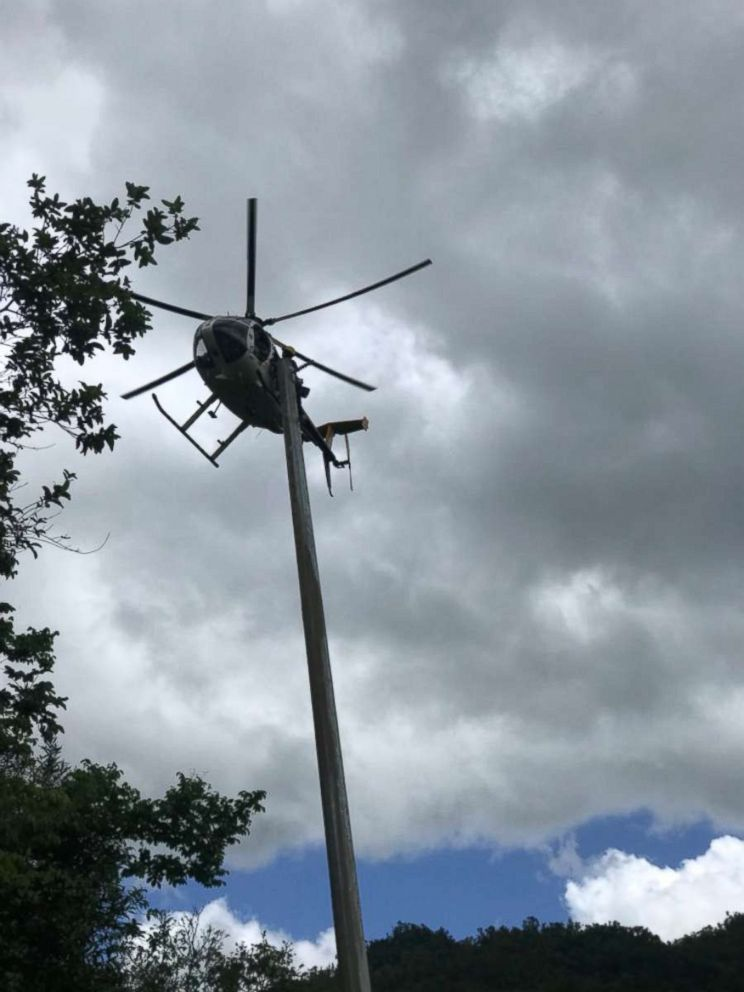 PHOTO: A helicopter participates in the operation to restore power to two homes in the Puerto Rican municipality Ponce.