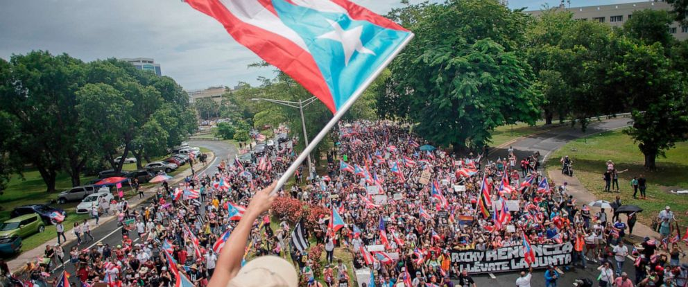PHOTO: People march in San Juan on July 25, 2019, one day after the resignation of Puerto Rico Governor Ricardo Rossello.