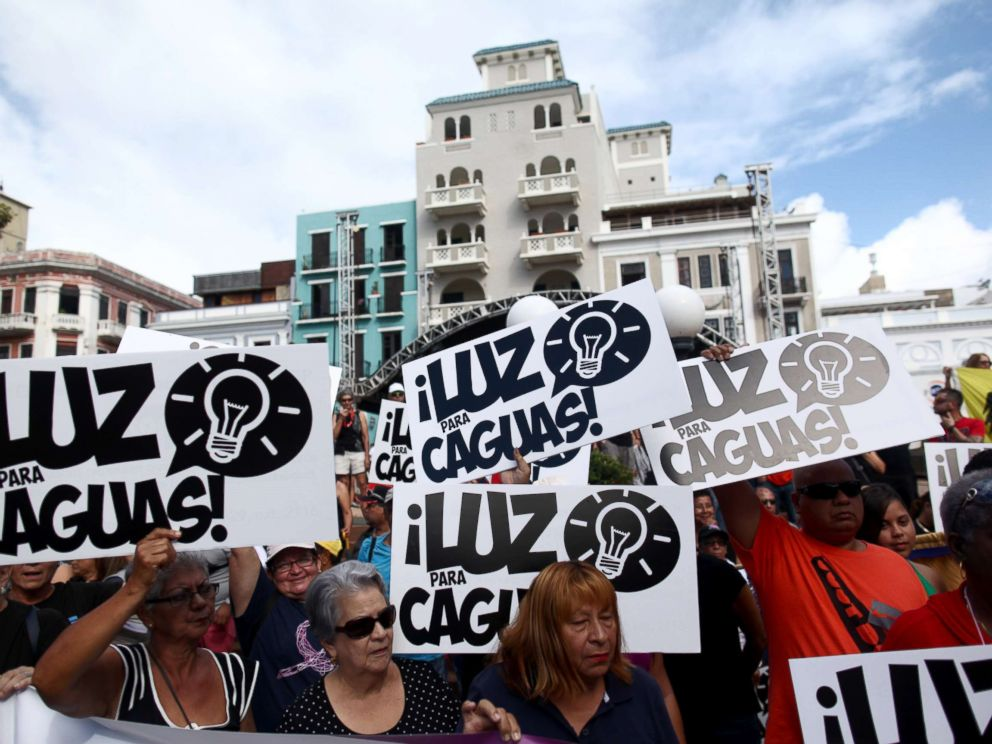 PHOTO: People hold signs reading Electricity for Caguas during a protest demanding that authorities fix the electrical grid which was mostly destroyed after Hurricanes Irma and Maria hit the island in September, in San Juan, Puerto Rico Jan. 15, 2018.