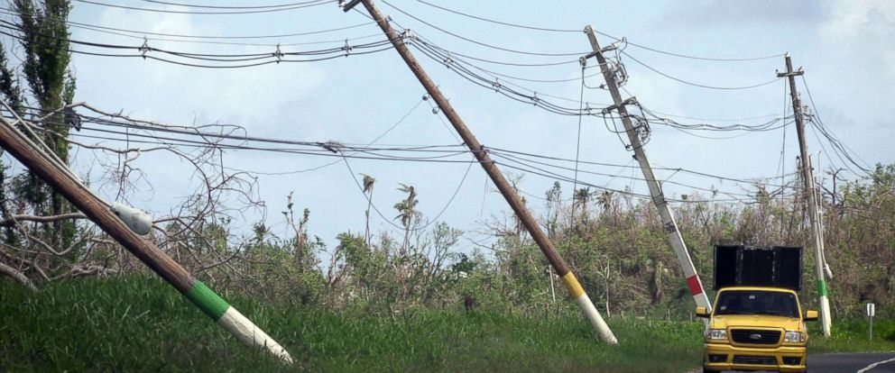 PHOTO: Power lines hang precariously on the side of the road on highway 118 near San Isidro, Puerto Rico, Oct. 14, 2017.