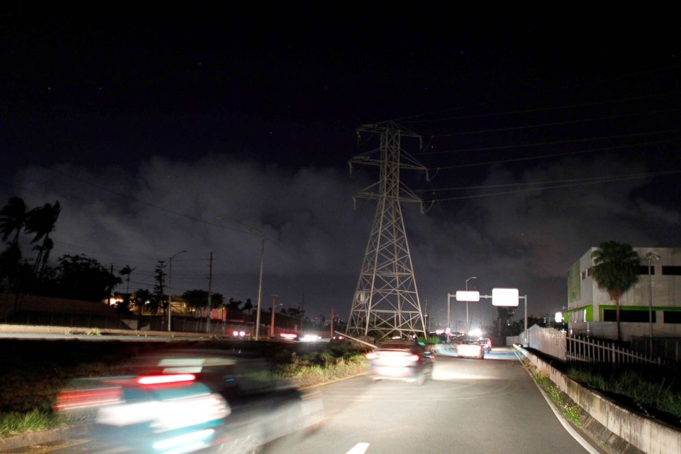 PHOTO: Ambulances are seen at the entrance of an electric substation after an explosion and fire was reported and caused a blackout in parts of San Juan, Feb. 11, 2018.