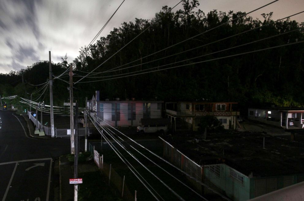 PHOTO: Houses are seen in the dark in a neighbourhood without electricity after the electrical grid was damaged by Hurricane Maria in September, in Dorado, Puerto Rico, Jan. 22, 2018.