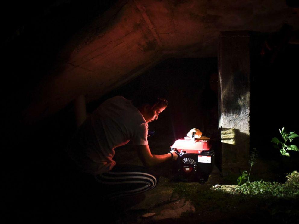 PHOTO: Barrio Patron resident Karina Santiago Gonzalez works on a small power plant in Morovis, Puerto Rico on Dec. 21, 2017.