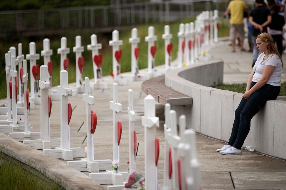 PHOTO: A woman visits a memorial with wooden crosses for each of the 49 victims of the Pulse Nightclub next to the Orlando Regional Medical Center, June 16, 2016 in Orlando, Fla.