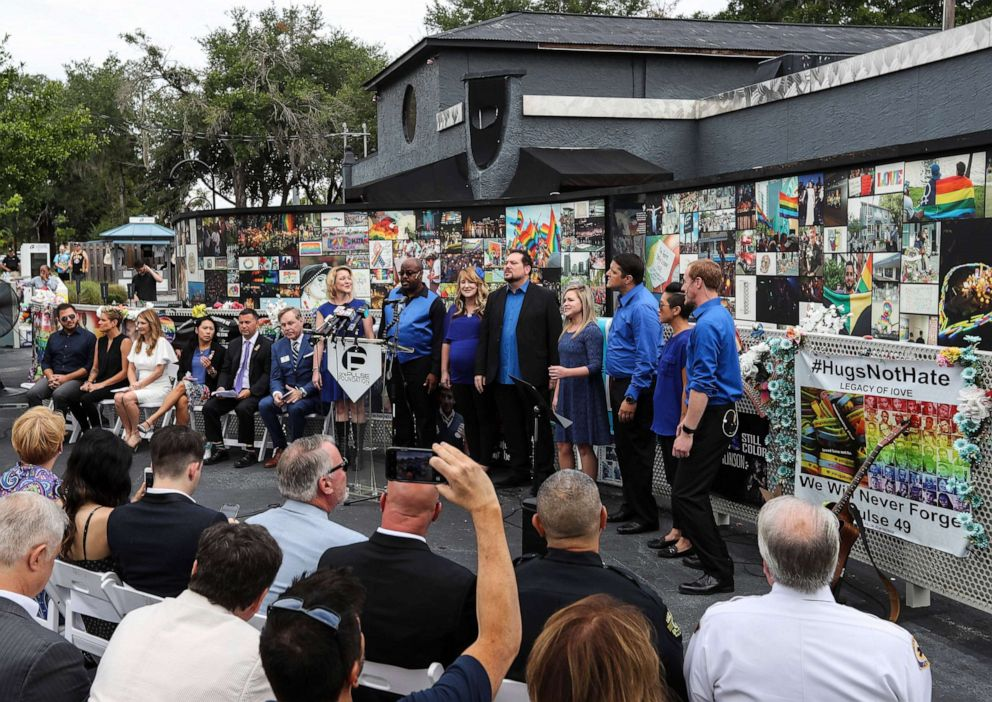PHOTO: A group from Central Florida Community Arts sings during an announcement from U.S. Representatives Stephanie Murphy, Darren Soto, and Val Demings on June 10, 2019, at the Pulse Interim Memorial, in Orlando, Fla.