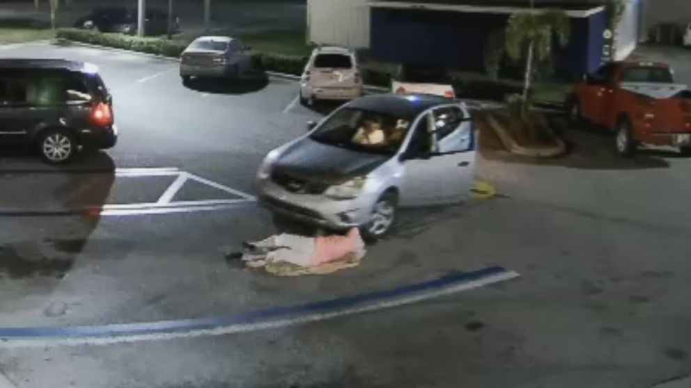 The driver dragged the woman before she fell to the ground, the tires narrowly missing her head.