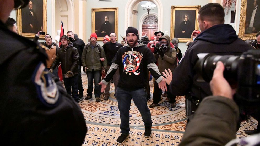 QAnon emerges as recurring theme of criminal cases tied to US Capitol siege