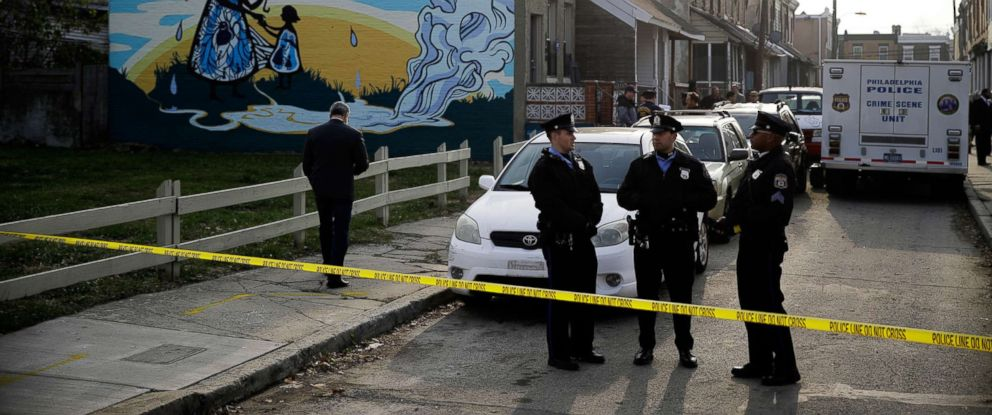 PHOTO: Police gather at the scene of a fatal shooting in the center row home in Philadelphia, Nov. 19, 2018.