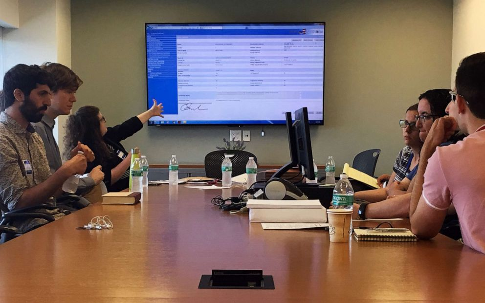 PHOTO: Renee Paradis, a lawyer for Tiffany Cabans campaign for Queens district attorney, gestures towards a screen during a meeting with the Queens Board of Elections and representatives from Melinda Katzs campaign on July 5, 2019.