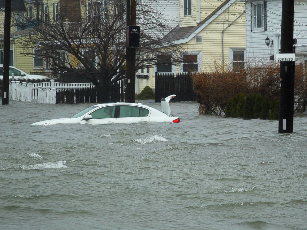 A car along Sea Street, is under several feet of water during the storm, Friday, March 2, 2018 in Quincy, Mass.