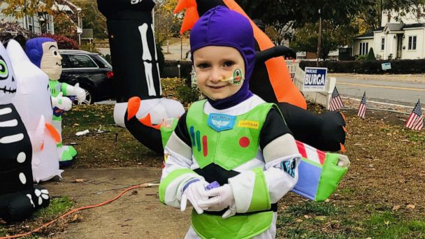 3-year-old known as 'Mighty Quinn' goes trick-or-treating after 100 days of isolation due to cancer treatment