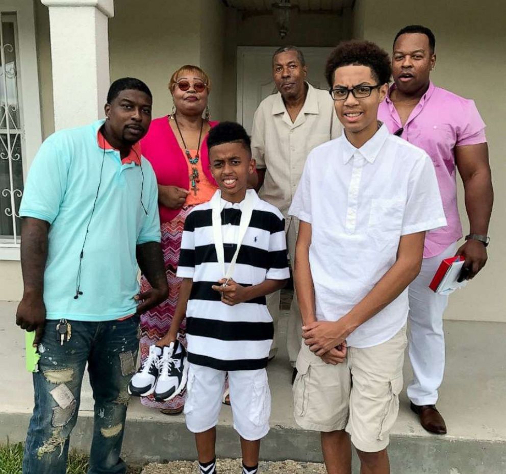 PHOTO: Quinnyon Wimberly, mother Irene Wimberly, son Quinnyon Wimberly II, father Frank Wimberly Sr., nephew Jordan Wimberly and brother Frank Wimberly Jr. pose for a family photo.