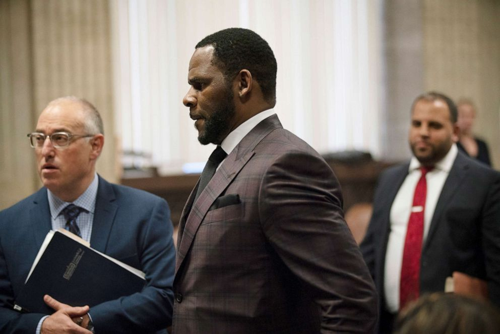 PHOTO: R&B singer R. Kelly (C) appears at a hearing before Judge Lawrence Flood at Leighton Criminal Court Building June 26, 2019 in Chicago, Illinois.