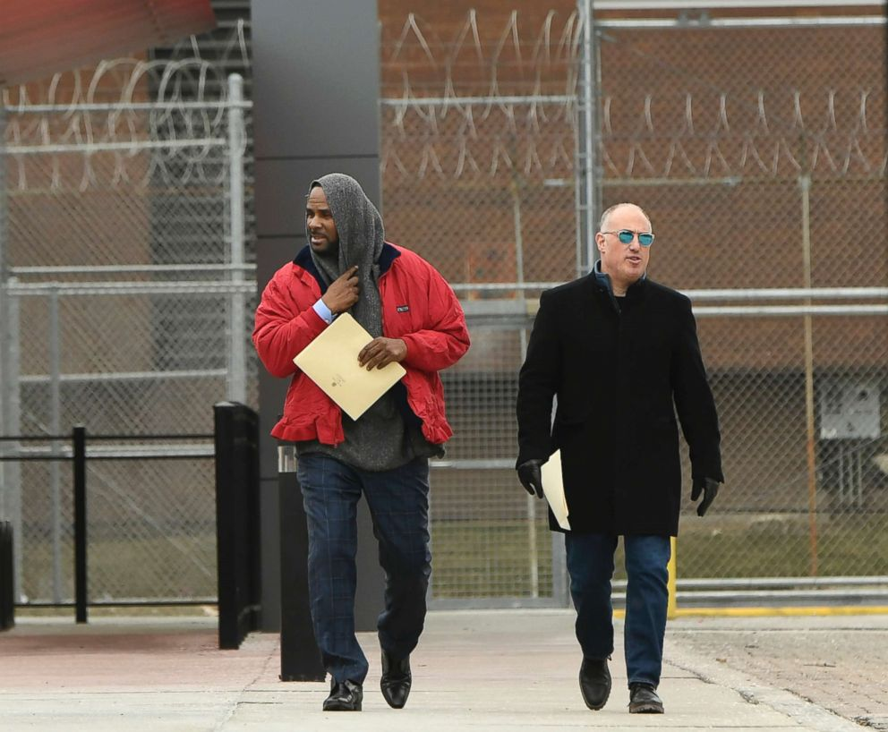 Singer R. Kelly, left, walks with his attorney Steve Greenberg after being released from Cook County Jail in Chicago,  March 9, 2019.