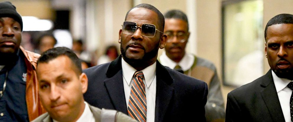 PHOTO: Musician R. Kelly, center, leaves the Daley Center after a hearing in his child support case, May 8, 2019, in Chicago.