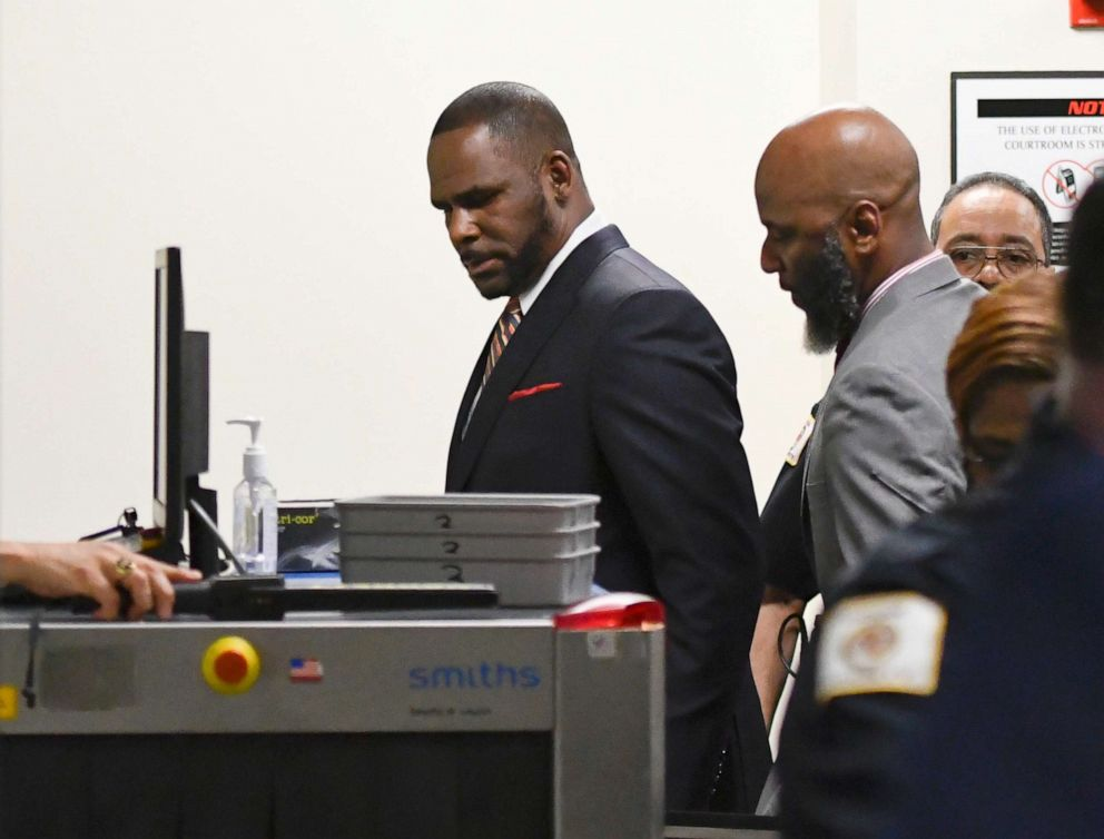 PHOTO: Musician R. Kelly, center, goes through security after he arrives at the Daley Center for a hearing in his child support case, May 8, 2019, in Chicago.