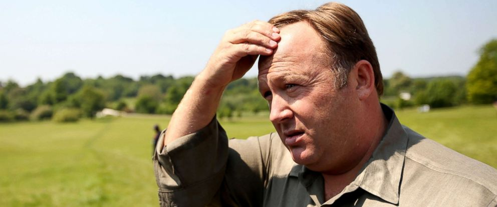 PHOTO: Alex Jones addresses media and protesters in the encampment outside The Grove hotel, June 6, 2013, in Watford, England.