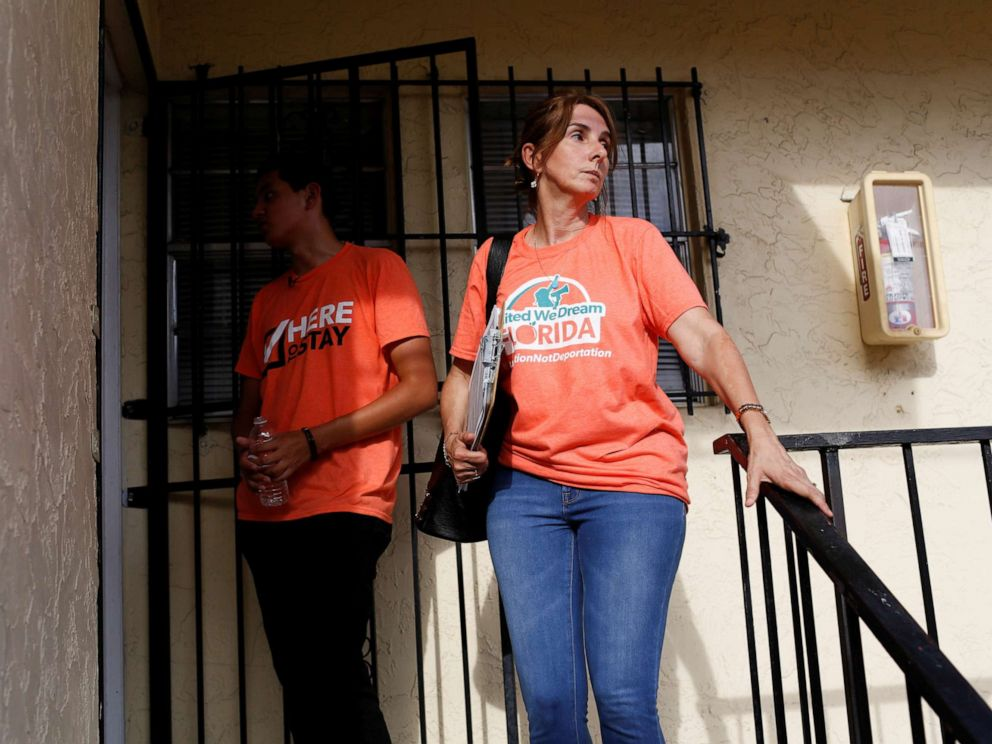 PHOTO: Immigration rights activists wait in front of the door of a house as communities braced for a reported wave of deportation raids across the United States by Immigration and Customs Enforcement officers, in Miami, July 13, 2019.