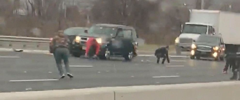 PHOTO: People got out of their cars to pick up cash that had spilled out of an armored truck on Route 3 in East Rutherford, New Jersey, Dec. 13, 2018.