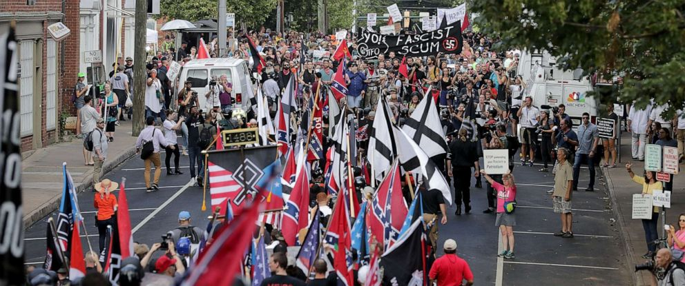 "PHOTO: Hundreds of white nationalists, neo-Nazis and members of the ""alt-right"" march down East Market Street toward Emancipation Park during the ""Unite the Right"" rally August 12, 2017 in Charlottesville, Virginia."