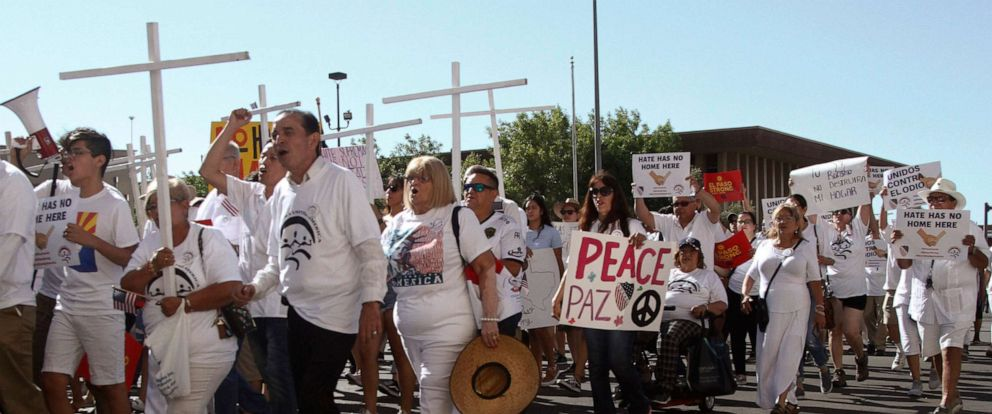 "PHOTO: Participants in the League of United Latin American Citizens ""March For a United America,"" carry signs in El Paso, Texas, on Saturday, Aug. 10, 2019."