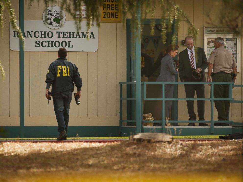 PHOTO: FBI agents are seen behind yellow crime scene tape outside Rancho Tehama Elementary School after a shooting in the morning on Nov. 14, 2017, in Rancho Tehama, Calif.