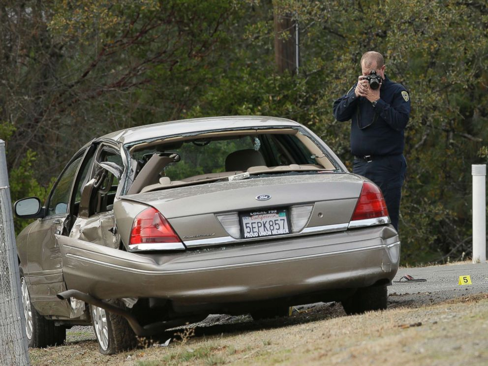 PHOTO: A California Highway patrol officer photographs a vehicle involved in a deadly shooting rampage at the Rancho Tehama Reserve, near Corning, Calif., Nov. 14, 2017.