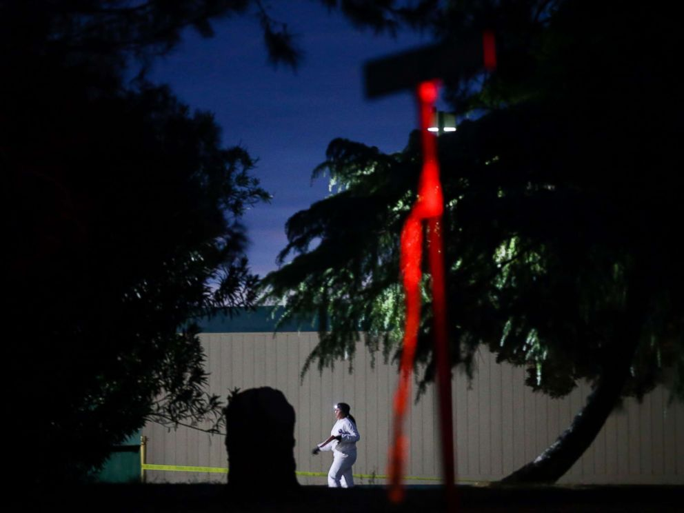 PHOTO: A woman wearing a white protective suit is seen on the Rancho Tehama Elementary school grounds after a shooting on Nov. 14, 2017, in Rancho Tehama, Calif.