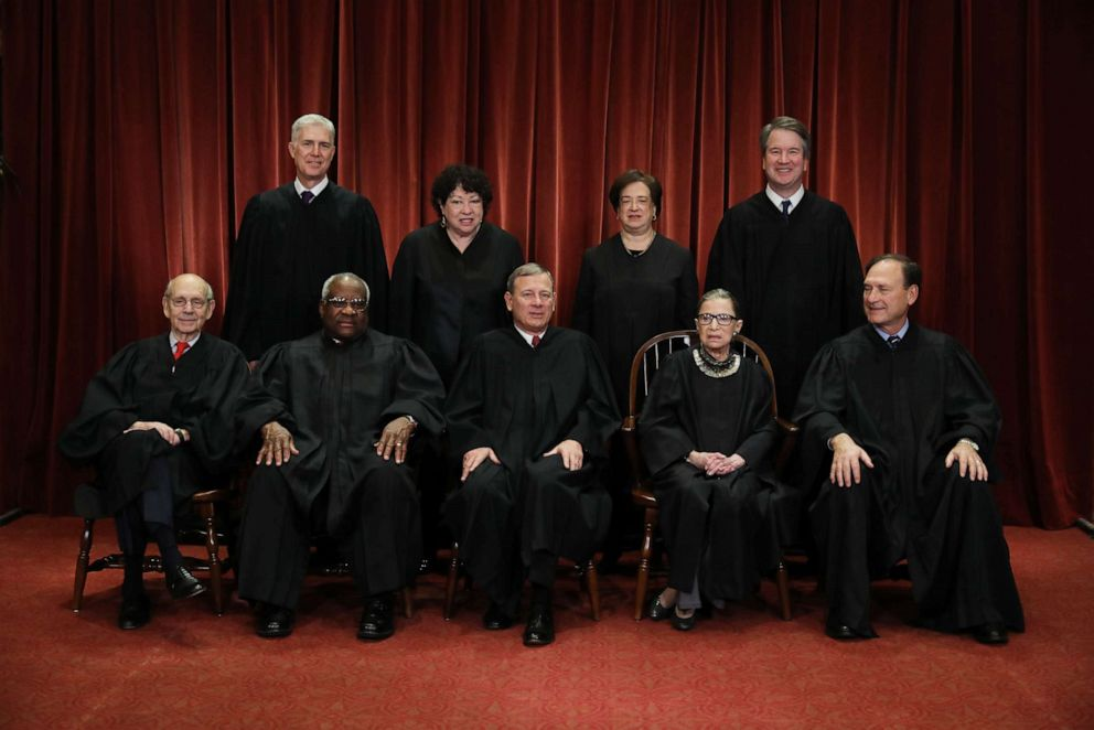 PHOTO: Associate Justice Ruth Bader Ginsburg sits with her colleagues on the United States Supreme Court during a group portrait after Associate Justice Brett Kavanaugh joined the court on Nov. 30, 2018, in Washington.