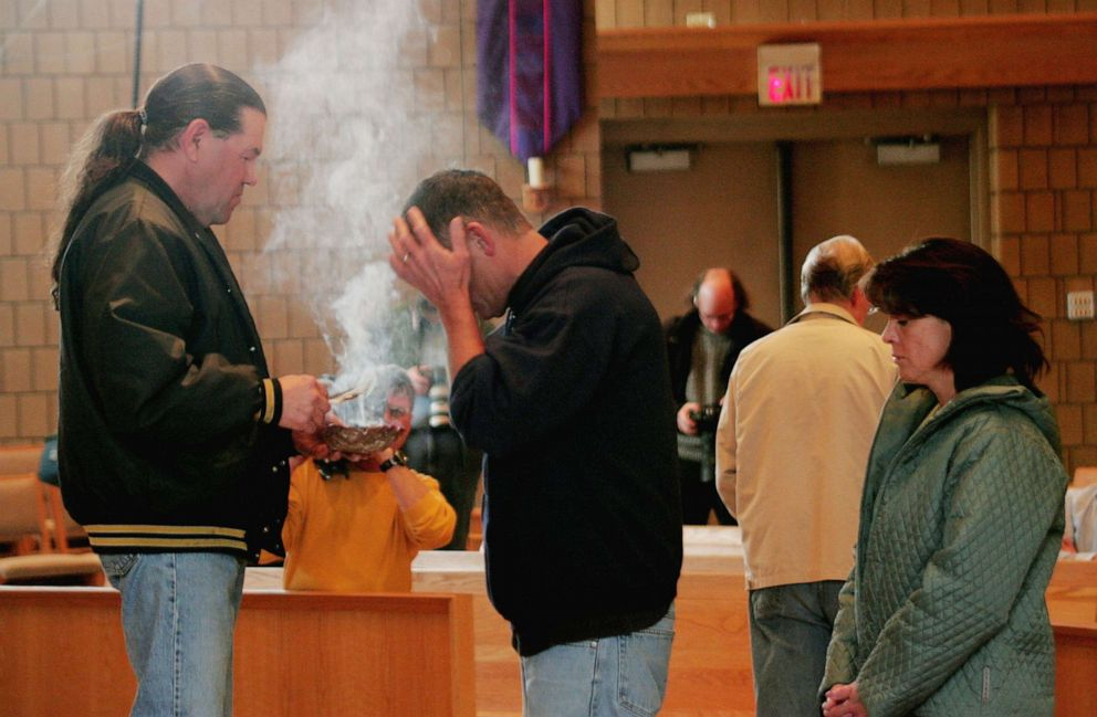 PHOTO: Robert Cook from the Red Lake Indian Reservation, performs a traditional ceremony at St. Phillip Church during a memorial service to mourn the victims killed at Red Lake High School, March 23, 2005, in Bemidji, Minn.
