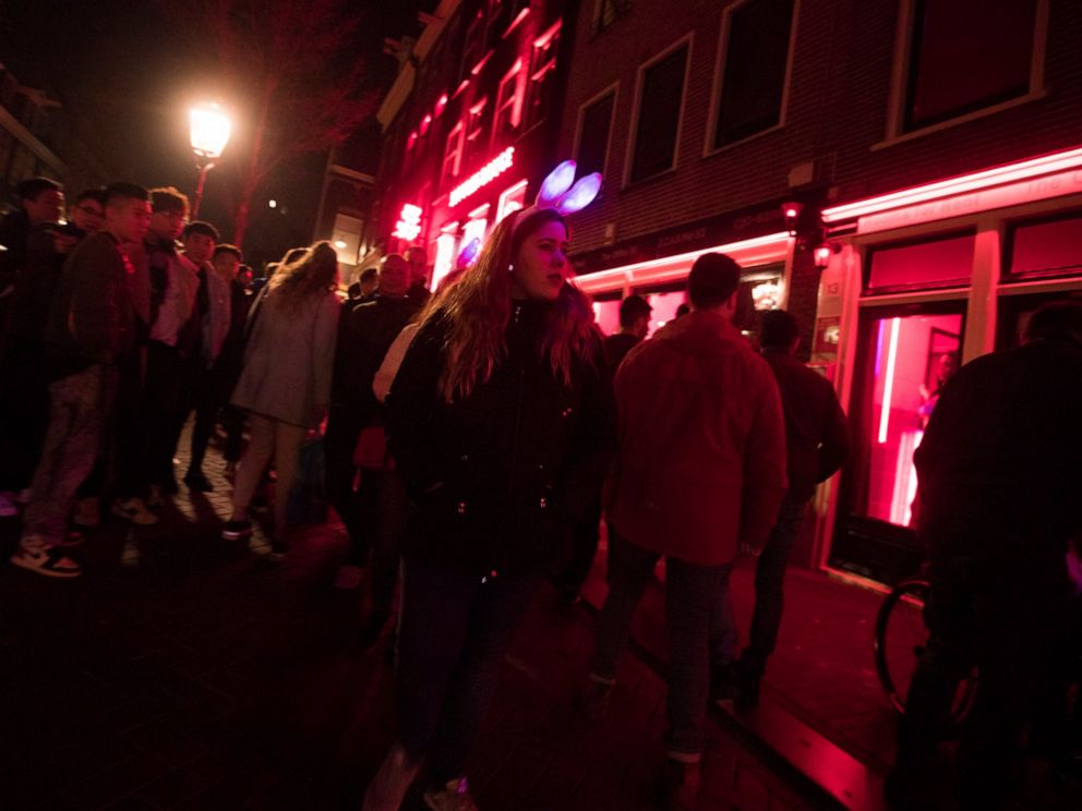 PHOTO: Tourists crowd the narrow canal-side streets in Amsterdams red light district, Netherlands, Friday evening, March 29, 2019.