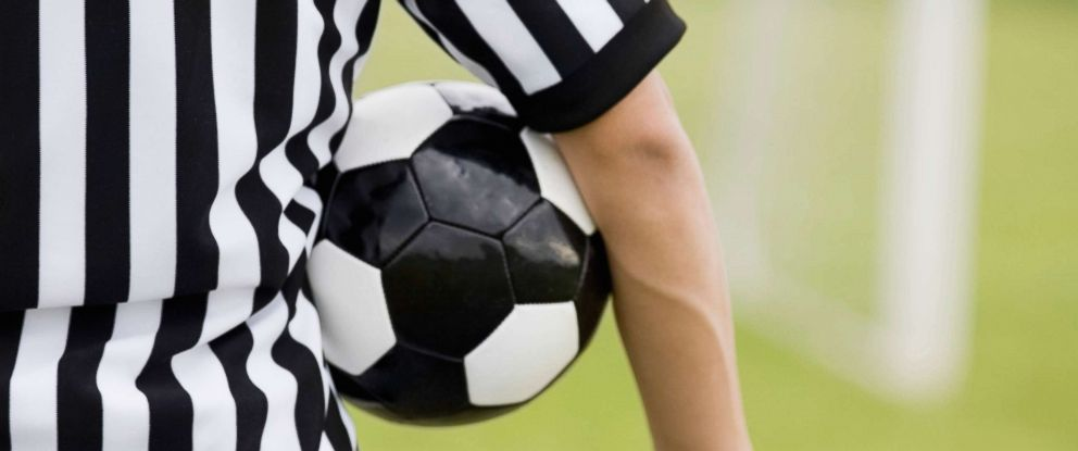 PHOTO: A referee is pictured with a soccer ball under his arm in this undated stock photo.