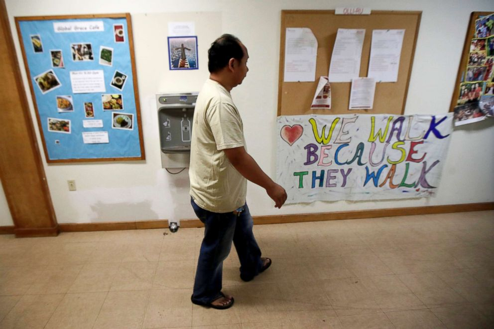 PHOTO: Arthur Jemmy walks through a hallway at The Reformed Church of Highland Park, where he and his wife are taking sanctuary to avoid deportation in Highland Park, N.J.