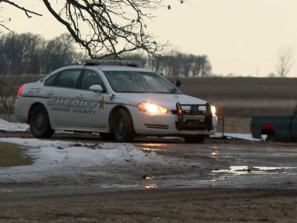 Dodge County sheriffs investigate the scene outside Lois Reiss home in Blooming Prairie, Minnesota, on March 23, 2018. Reiss is suspected in the murder of her husband, David.