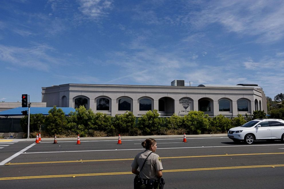 PHOTO: A San Diego County Sheriffs deputy directs traffic in front of the Chabad of Poway Synagogue on Sunday, April 28, 2019 in Poway, Calif.