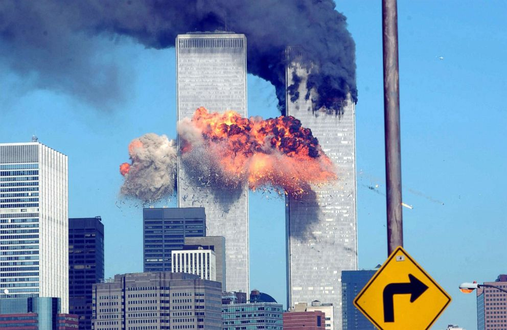PHOTO: A fiery blasts rocks the World Trade Center after being hit by two planes on Sept. 11, 2001, in New York City.