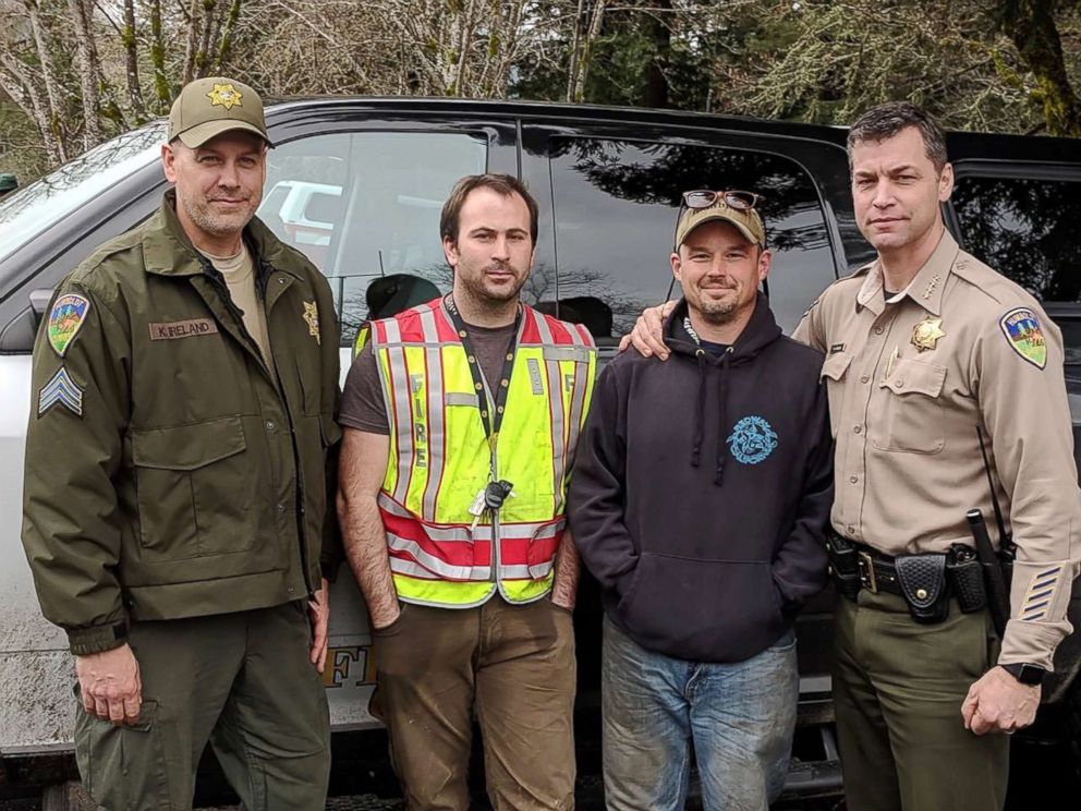 PHOTO: From left, Humboldt County Sheriff Sgt. Kerry Ireland, Piercy, California, Firefighter Abram Hill, Piercy Fire Chief Chumley and Humboldt County Sheriff William Honsal. Hill and Chumley found two missing sister lost in the forest on Sunday.