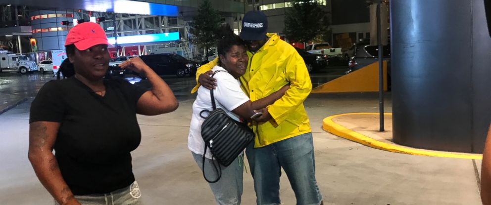 PHOTO: Iashia Nelson, who was stranded on the roof of a neighbor's two-story home with family members and neighbors, was reunited with James Murphy, the stranger who came to their rescue.