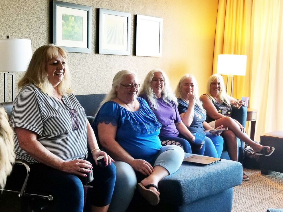 PHOTO: Vicky Love and her younger sisters, Kala, Nena, Ruth, and Jan sit together after meeting for the first time in Omaha, Neb., on June, 15, 2018.