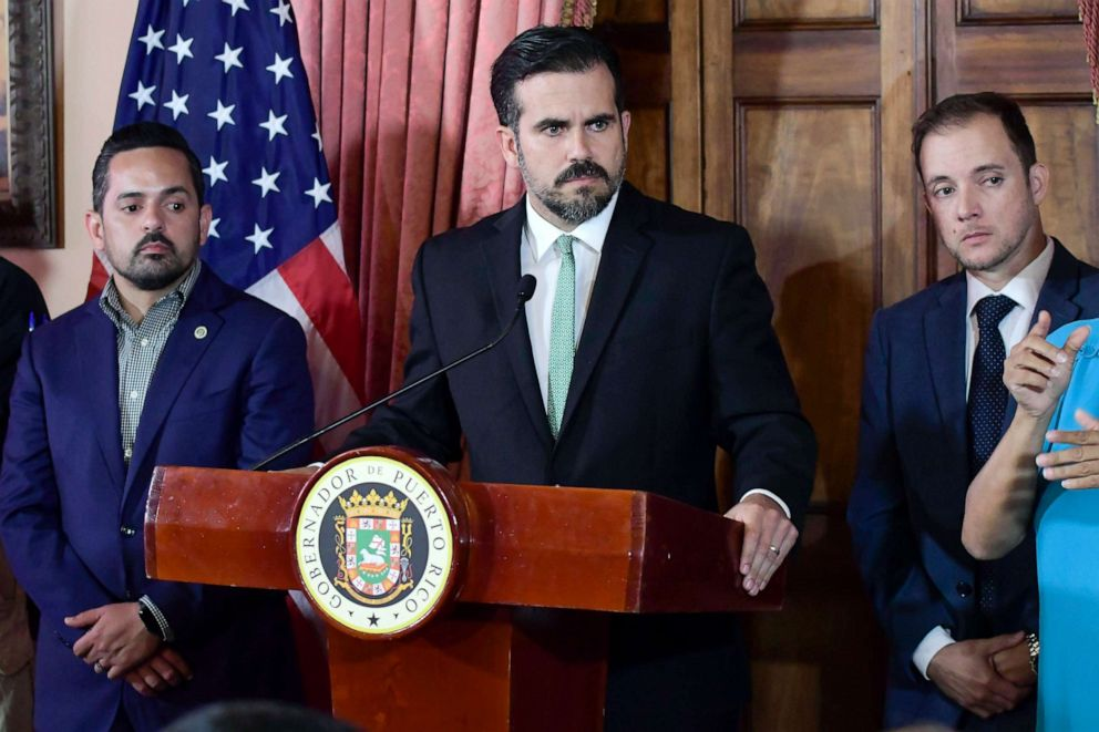 PHOTO: Puerto Rico Gov. Ricardo Rossello, accompanied by his chief of staff Ricardo Llerandi, right, attends a press conference in La Fortalezas Tea Room, in San Juan, Puerto Rico.