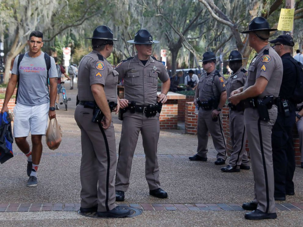 PHOTO: Florida Highway Patrol officers stand guard the day before a speech by Richard Spencer, an avowed white nationalist and spokesperson for the so-called alt-right movement, on the campus of the University of Florida, Oct. 18, 2017.